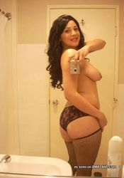 Picture collection of a topless chick in fishnet stockings from GF Melons