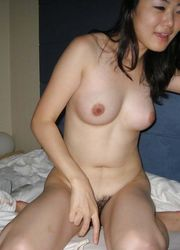 Photo gallery of an amateur naked Chinese slut in a motel from MeAndMyAsian