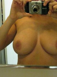Kinky busty chick displaying her big juggs and moist pussy from Sluts With Phones