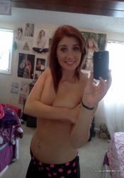 Photos of a sexy camwhoring amateur hottie showing her tits from The GF Network