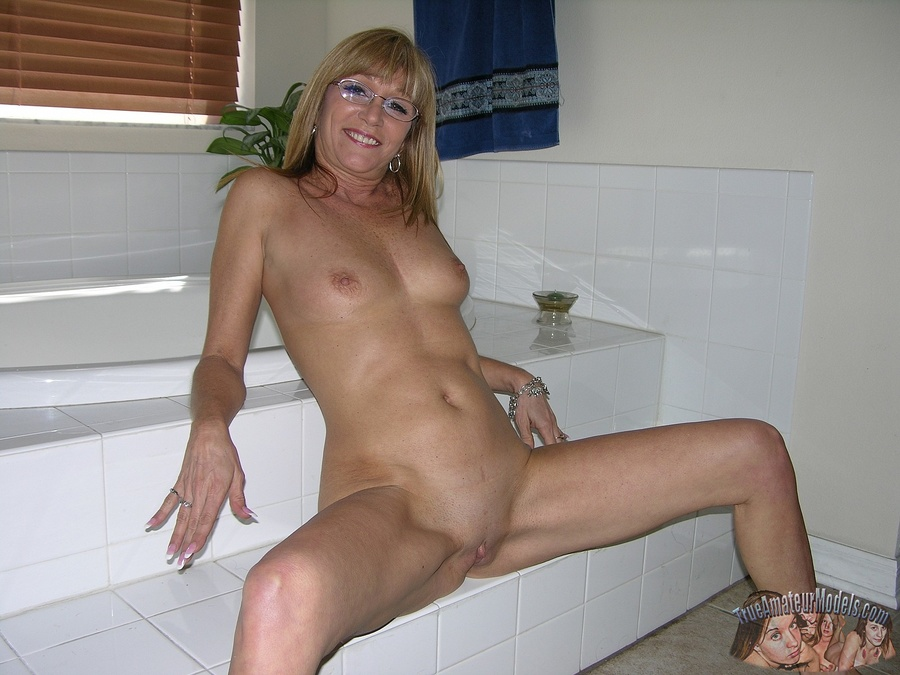 year old milf with glasses modeling and spreading nude from true